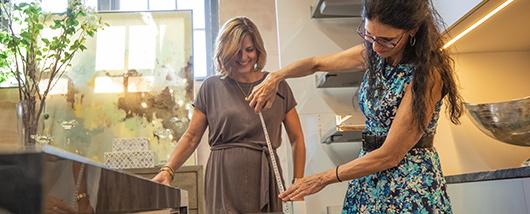 Sarah DeWitt measuring an item in the showroom