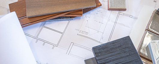 Design drawings with samples on a flat surface
