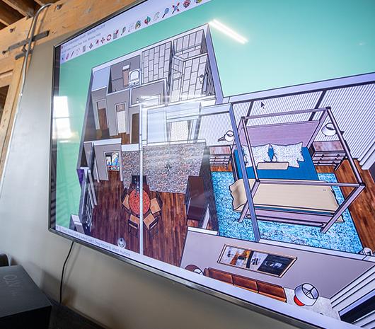 DeWitt house designs on a big TV screen