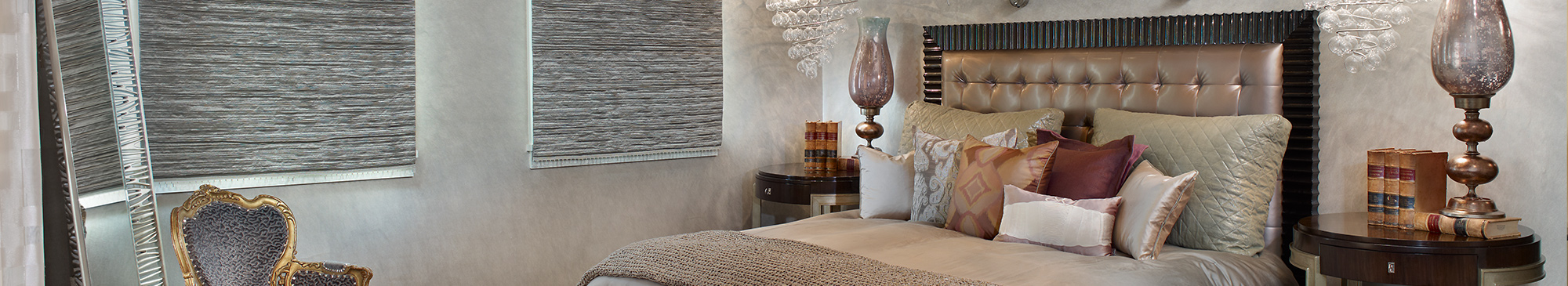 Bedroom with lots of grey and brown designed by DeWitt