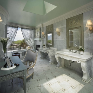 Bathroom with grey tiles on the floor and walls and white marble vanities