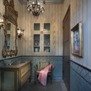 Bathroom with striped wallpaper and blue subway tiles