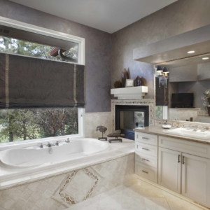 Bathroom with light tiled floors and a cream vanity and grey lime washed walls