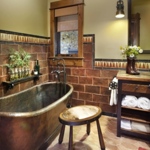 Bathroom with tiled floors and walls and a brown metal tub