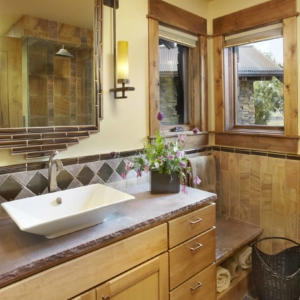 Bathroom with yellow walls and a light wooden vanity