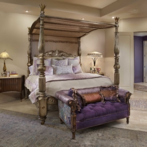 Bedroom with neutral walls, purple accents and a grand four-post bed frame