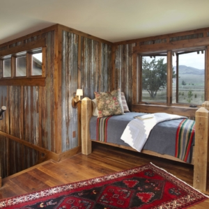 Small bedroom with metal walls and wooden framing