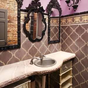 Bathroom with mixed tiles and grand mirrors