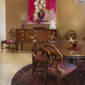 Dining room with round table and wooden sideboard