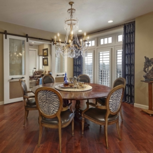 Dining room with round table and zebra print chairs