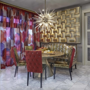 dining room with tiled floors, grey walls and pink and purple drapes on window