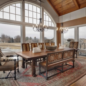 Dining room with several windows and animal print chairs