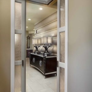 Door opening into a hallway with a dark wooden console table