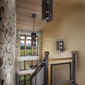 Hallway lined with a stone wall
