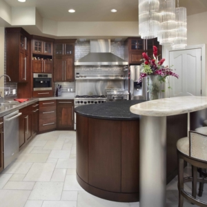 Kitchen with light walls, tiled floors and dark wood cabinets