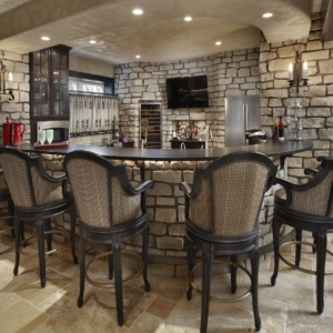 Kitchen with stone walls, tiled floors and a accent wall with red plaid wallpaper