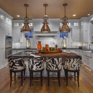 white cabinets with white tile backsplash and zebra print island stools