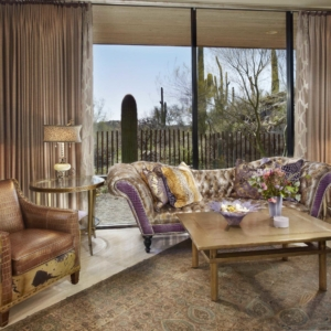 living room with floor to ceiling windows with fabric drapes open