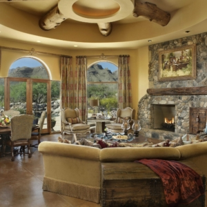 Yellow living room with stone fireplace