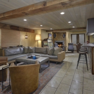 Basement living area with tiled floors and leather furniture