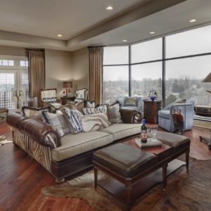 Large living room with dark wooden floors and animal print accents
