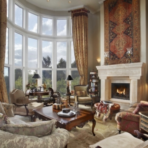 Bright living room with floor to ceiling windows and Persian accents