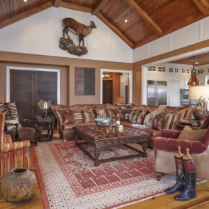 Living room with red accents and animal hanging on the wall