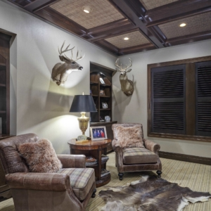 Brown leather chairs under deer heads