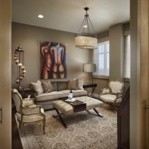 Sitting room with tan walls and neutral seating