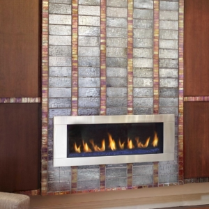 Tiled fireplace with fire lit