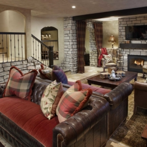 Basement living room with light walls and dark accents