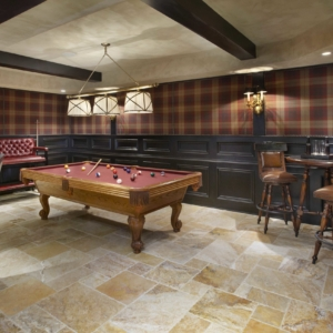 Basement with plaid walls and red pool table