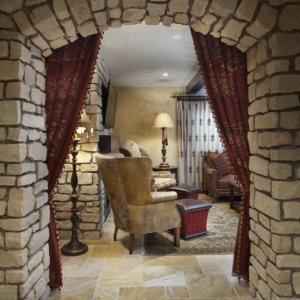 Stone arched entrance into sitting room